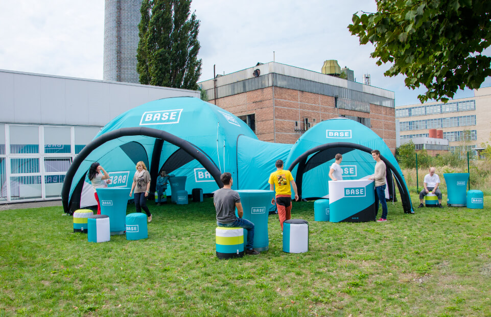 2 AXION Square Inflatable Event Tents linked with a tunnel for BASE